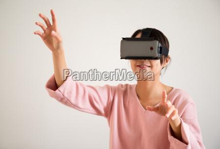 woman play tv game on virtual