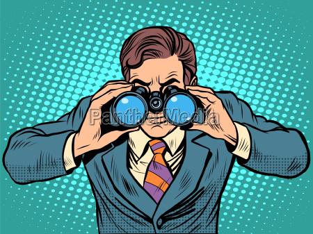 forretningsmand kigger gennem kikkerten lead vision