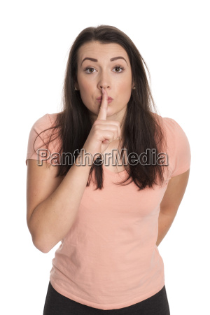 young woman gesturing to be quiet