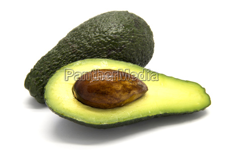 one whole and one sliced avocado