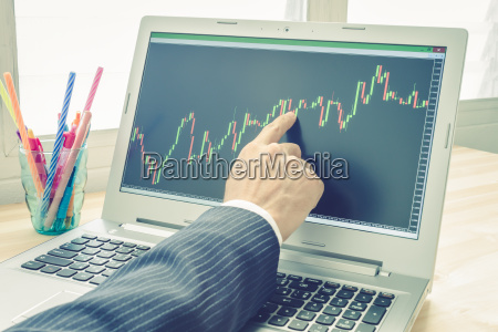 businessman point and analyze forex graph