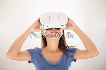 young woman watching virtual reality device