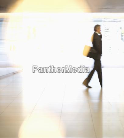 businessman walking in lobby