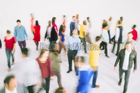businessman standing among bustling crowd