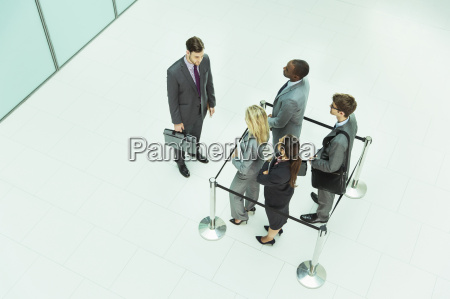 businessman standing outside roped off square