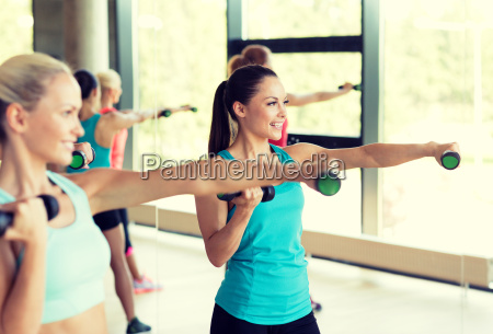 group of women with dumbbells in