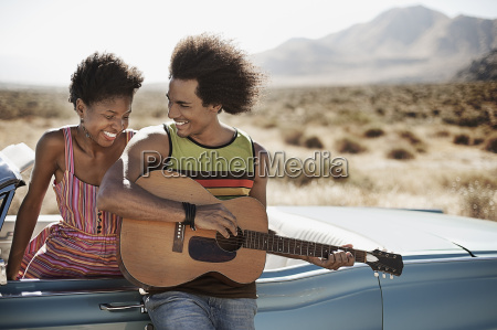 a young couple standing by a