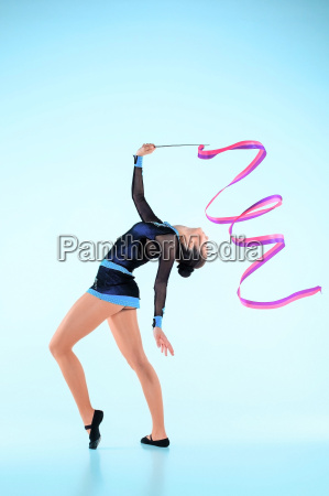 the girl doing gymnastics dance with