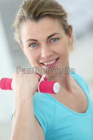 portrait of mature fitness woman lifting