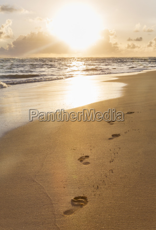 dominican rebublic footprints in sand at