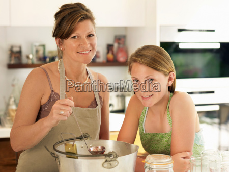 mother and daughter making jam