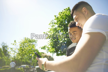 two young adult friends looking at