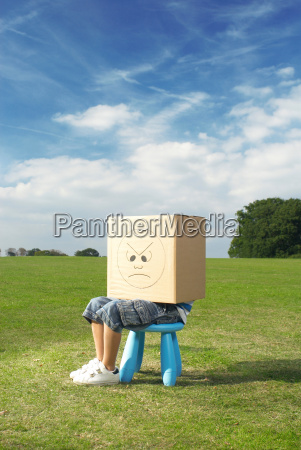 young boy on stool with box