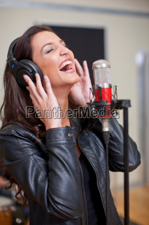young woman singing in studio