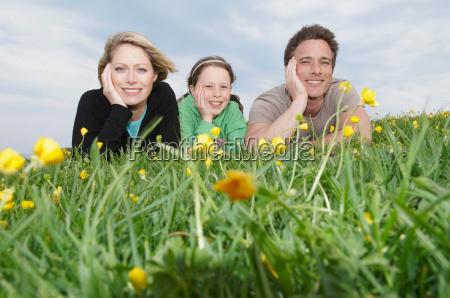 portrait of happy family lying on