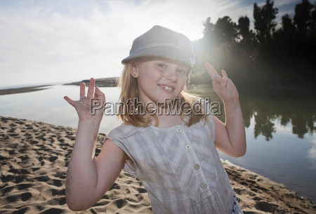 young girl at river smiling at