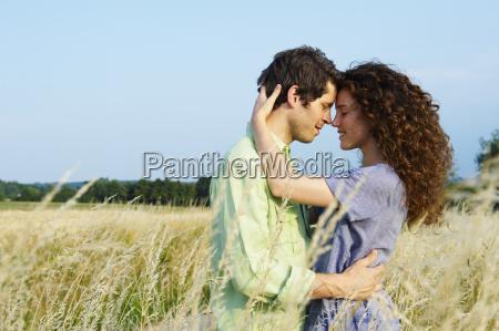 couple in a wheat field