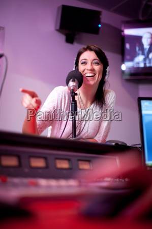 mid adult woman broadcasting in recording