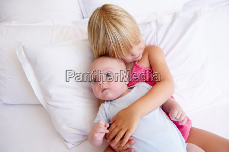 girl with her baby brother in