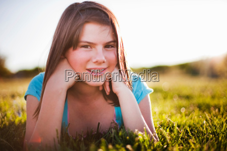young girl in grass smiling