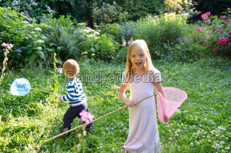 brother and sister with butterfly nets