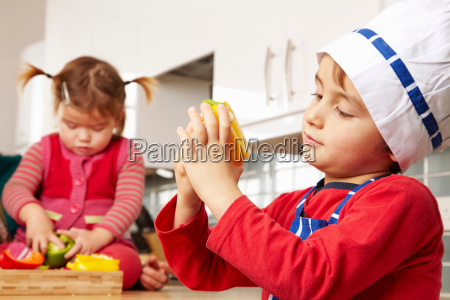 boy and girl looking at vegetables