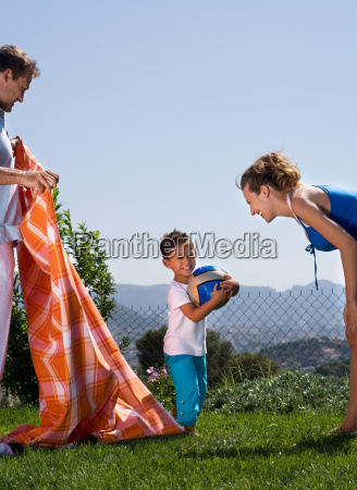 young family having a picnic