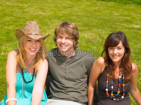 portrait of three young people sitting