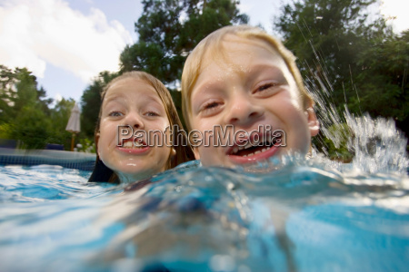 girls and boy in swimming pool