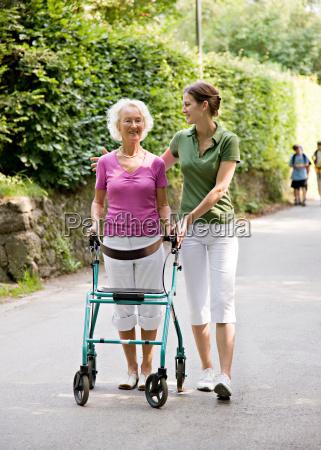 woman walking with senior woman