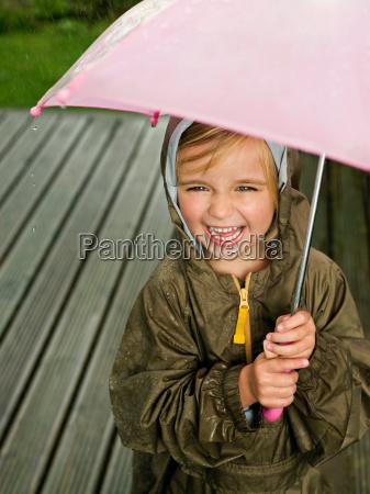 a young girl under an umbrella