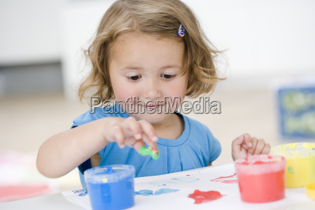 young girl playing with colours