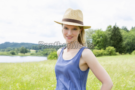 mid adult woman wearing sunhat portrait