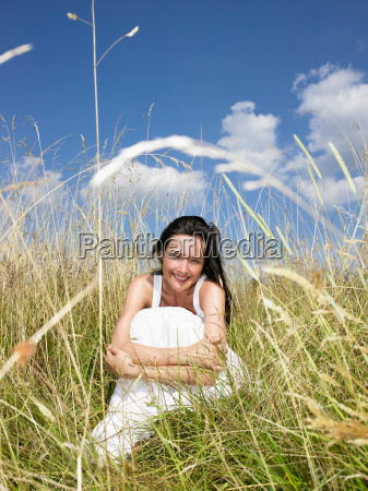 woman seated in a field