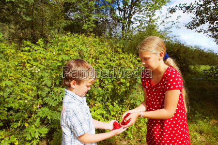 young girl and young boy outdoors