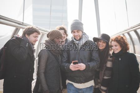 six young adult friends on footbridge
