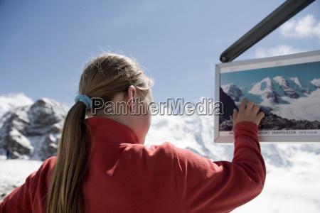girl looking around in mountainous area