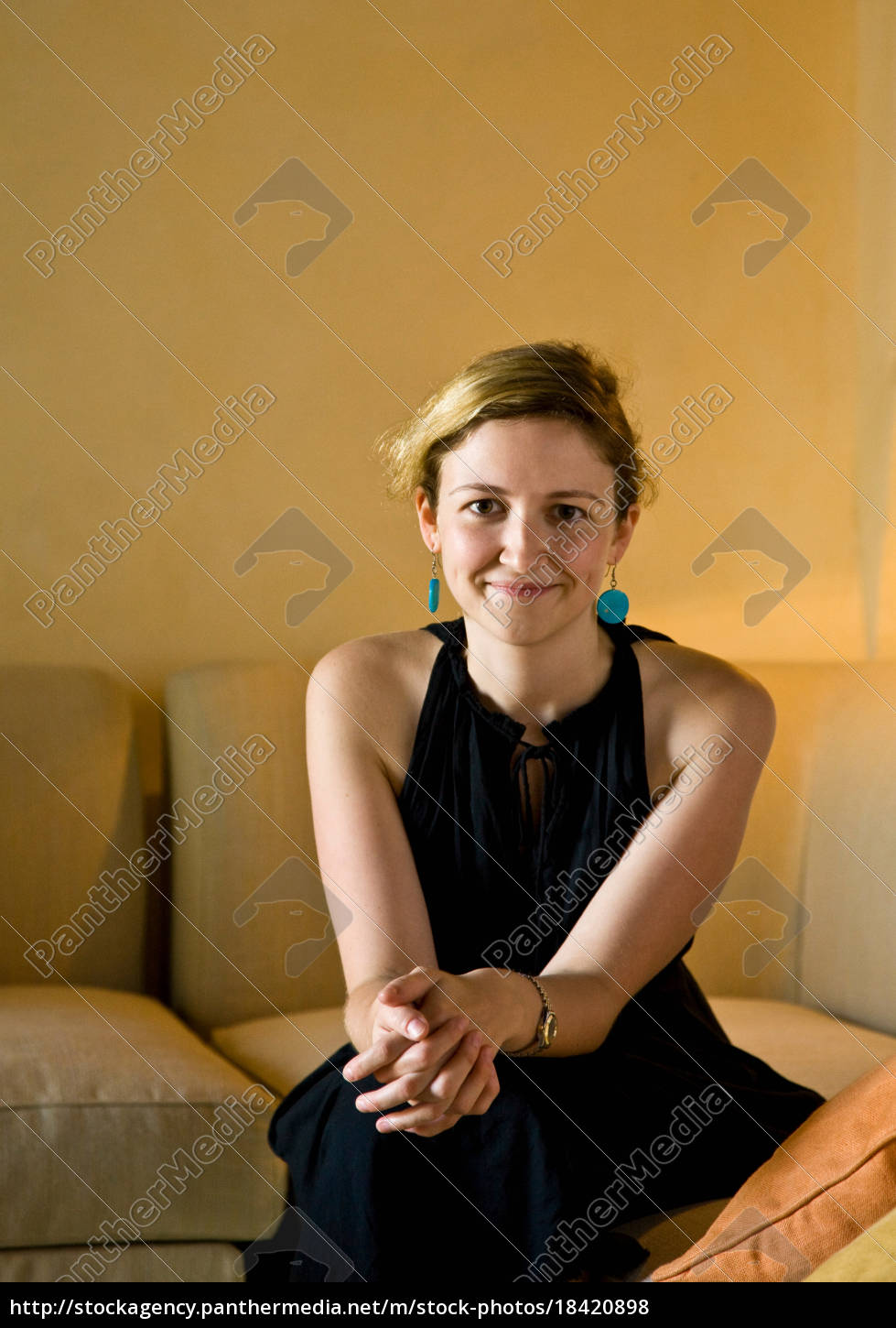 portrait, of, a, woman, sitting, on - 18420898