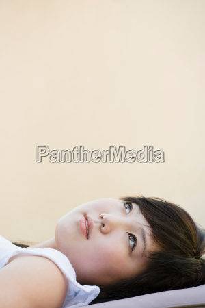 portrait of happy teen looking up