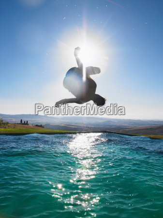 man jumping in swimming pool