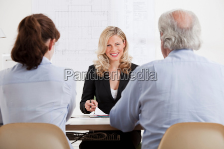 business woman talking to man and