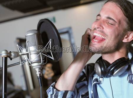 man singing in recording studio