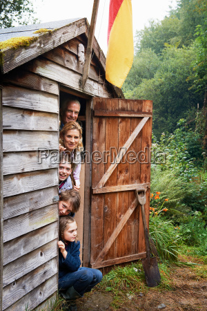 grandparents and children hiding in shed