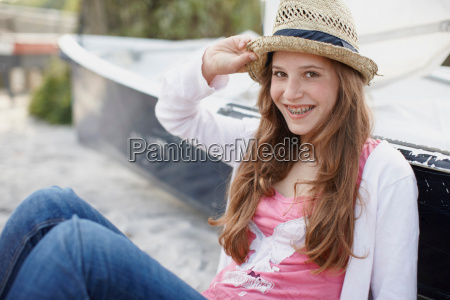 young girl at beach smiling in
