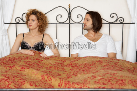 young couple in bed wearing underwear