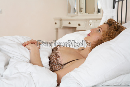 woman lying in bed looking up