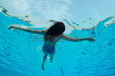 woman floating in swimming pool