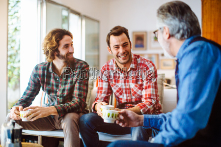 mature man and two adult sons