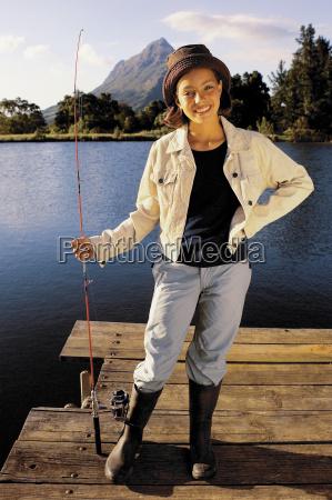 young girl fishing on a lake
