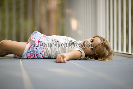 girl lying on floor